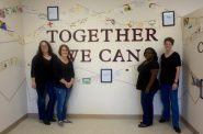 """Ali Kopyt, Emily Dalton-Niles, Erica Horton and Lori Albers (left to right) used the motto of the Avenues West neighborhood, """"Together we can"""" to inspire their project. Photo by Allison Dikanovic."""