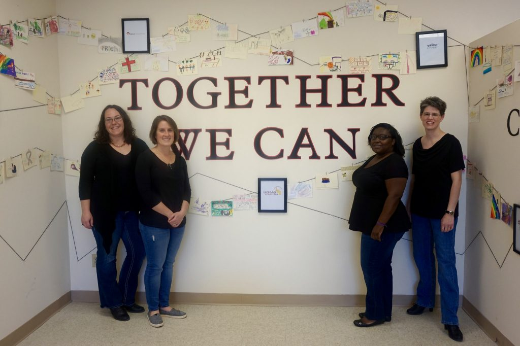 "Ali Kopyt, Emily Dalton-Niles, Erica Horton and Lori Albers (left to right) used the motto of the Avenues West neighborhood, ""Together we can"" to inspire their project. Photo by Allison Dikanovic."