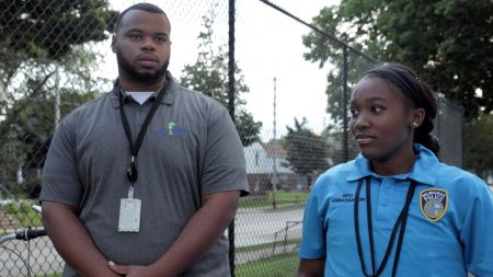 Derrick Shoates (left), District 3 youth organizer, and an MPD Ambassador attend a community event. Photo courtesy of Safe & Sound.