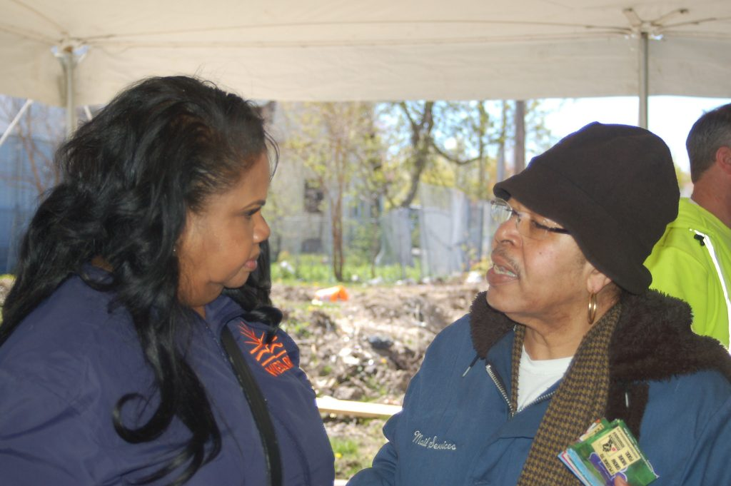 Elizabeth Coggs (left), regional vice president of WestCare Wisconsin, chats with Harambee resident Stephanie Kendrick. Photo by Naomi Waxman.