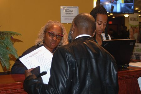 A Wisconsin Department of Motor Vehicles official fields questions from an attendee. Photo by Edgar Mendez.