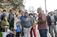 Damien Smith, Safe & Sound's District 5 youth organizer, leads Tamarack Waldorf School students on a tour of the Harambee neighborhood. Photo courtesy of Safe & Sound.