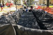 An enormous tarp is laid out to hold the 7,000-gallon cistern. Photo Courtesy of Arts @ Large.