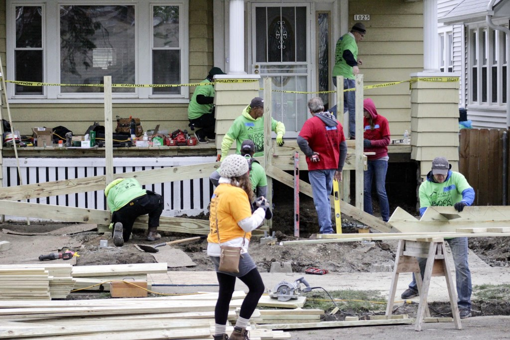 Volunteers build a handicap ramp for a physically challenged Clarke Square resident. Photo by Keith Schubert.