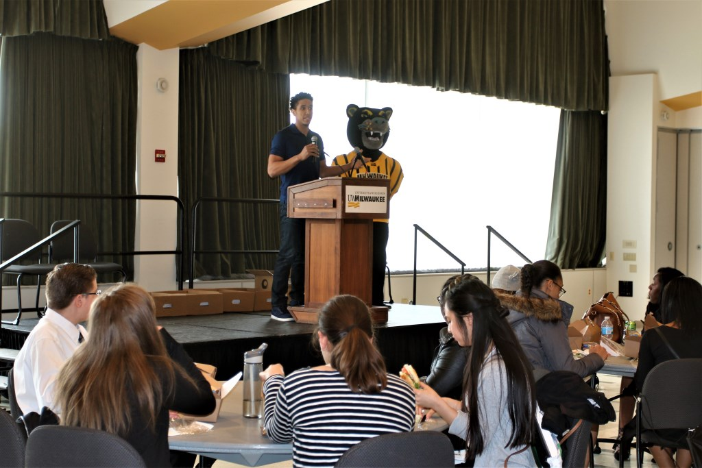 Malcom Brogdon, Milwaukee's basketball point guard, and Pounce, University of Wisconsin-Milwaukee Panthers mascot, at the Bank Your Future event.
