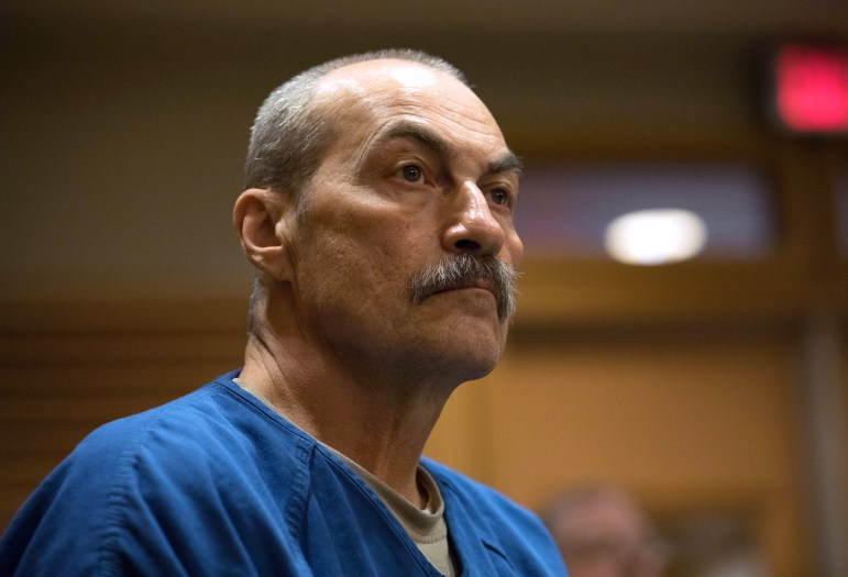 The case involving Richard Beranek, 58, is among 13 in Wisconsin which the FBI acknowledges it used flawed microscopic hair comparison. Beranek is awaiting a decision by Dane County Circuit Judge Daniel Moeser about whether he will get a new trial. He was convicted in 1990 of sexually assaulting a rural Stoughton woman and is serving a 243-year sentence. Beranek is pictured in a Dane County courtroom on Feb. 14. Photo by Coburn Dukehart of the Wisconsin Center for Investigative Journalism.
