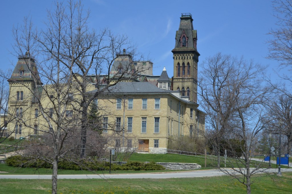 Headquarters Building with Old Main behind. Photo by Christopher Hillard.