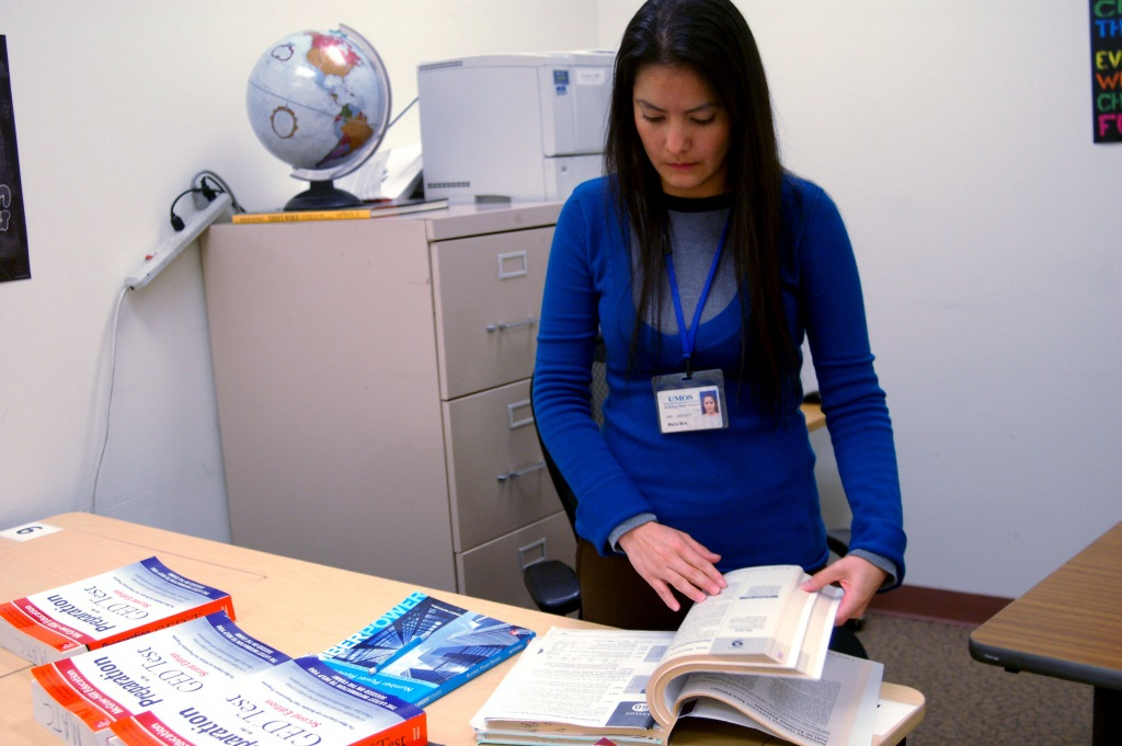 UMOS GED instructor Maria Madrigal-Alvarez scans the prep material for a lesson. Photo by Edgar Mendez.