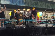 The Sculpture Milwaukee ribbon is cut as Jenny Thiel performs. Photo by Jeramey Jannene.