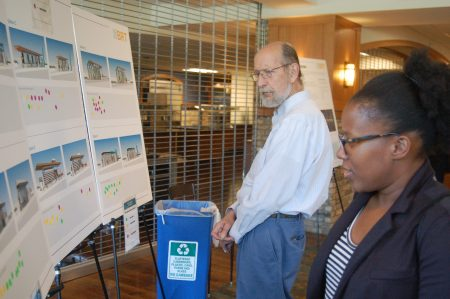 Pepper Ray (right), who attended an open house for the East-West Bus Rapid Transit line recently, said she's skeptical of the plan's impact on central city residents. Photo by Edgar Mendez.