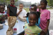 Kids enjoy a free meal program provided by the Milwaukee Summer Food Service program. Photo courtesy of Hunger Task Force.