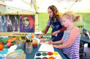 The Kohl's Color Wheels tent, Team Coordinator Liala Amin, and Lucy Klassen, from Milwaukee. Photo by Erol Reyal©
