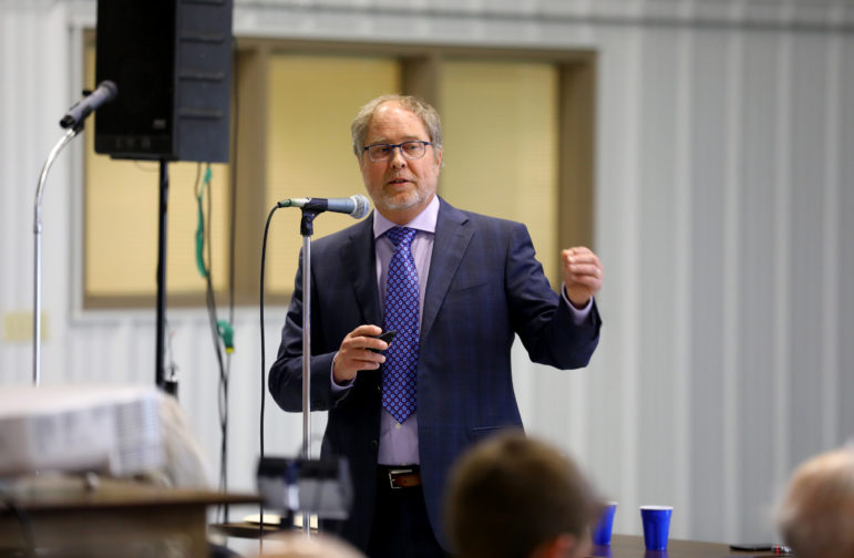 Mark Borchardt, a microbiologist with the U.S. Department of Agriculture's Agricultural Research Service, presented data on water contamination in Kewaunee County during a meeting at the Expo Hall at the Kewaunee County Fairgrounds, June 7, 2017. Scientists found both bovine and human waste are to blame. Photo by Coburn Dukehart of the Wisconsin Center for Investigative Journalism.
