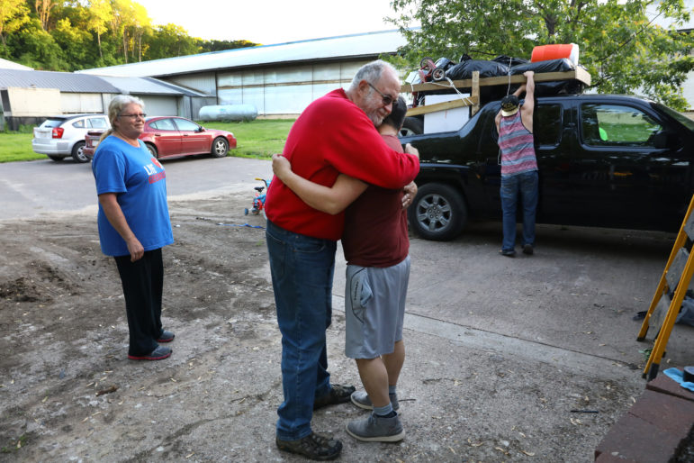 "Doug Knoepke, owner of a large dairy farm in Pepin County, Wis., hugs Miguel Hernandez on May 31, as he prepares to leave after 16 years. ""I don't know where the industry would be without (immigrant labor) right now,"" says Knoepke. Miguel, his assistant herdsman and ""right hand"" man has proven difficult to replace. Photo by Coburn Dukehart of the Wisconsin Center for Investigative Journalism."