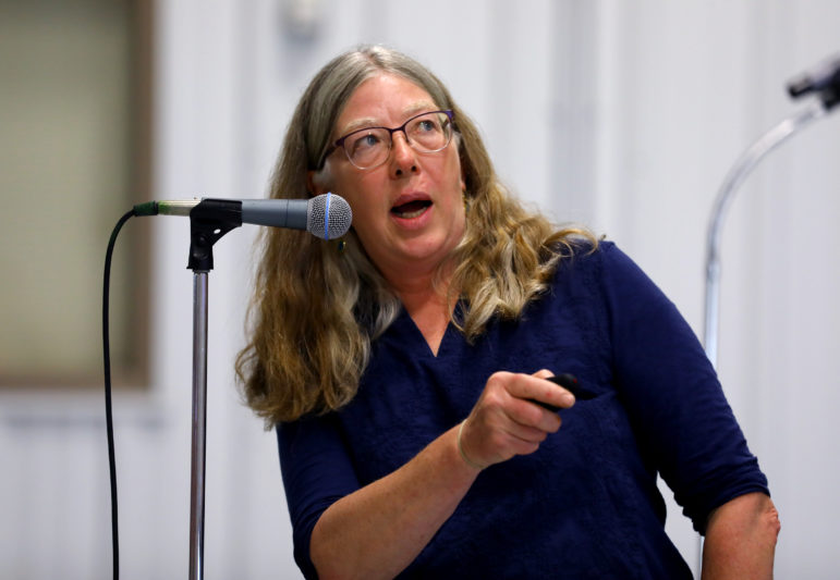 "Maureen Muldoon stressed the variability of well results due to rapid flow of water through the aquifer. ""Your well can be fine one day, then contaminated, then fine again,"" Muldoon said. Photo by Coburn Dukehart of the Wisconsin Center for Investigative Journalism."