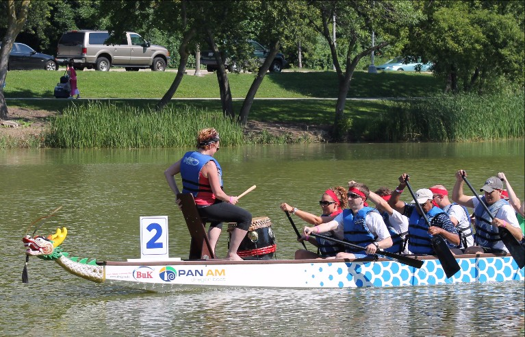 A 21-member dragon boat racing team strokes to the beat of its drummer at the Milwaukee Dragon Boat Festival. Photo from Milwaukee County Parks.