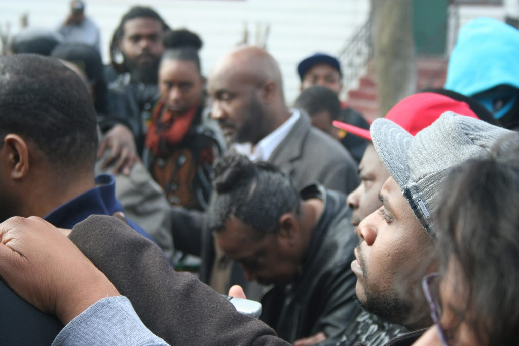 Black residents, leaders and elected officials stand in solidarity at a Garden Homes press conference in early 2015 that marked the beginning of the Safe Zones Initiative. Photo by Jabril Faraj.