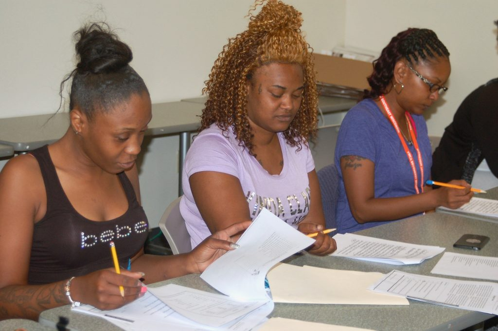 Schivon Young, 32, (left), Whitney Burks, 28, (center) and Kimberly Collins are weeks away from obtaining their high school equivalency diplomas. Photo by Edgar Mendez.
