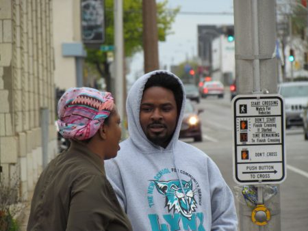 Khalil Coleman (in grey) speaks with a neighborhood resident near 16th Street and North Avenue. Photo by Jabril Faraj.