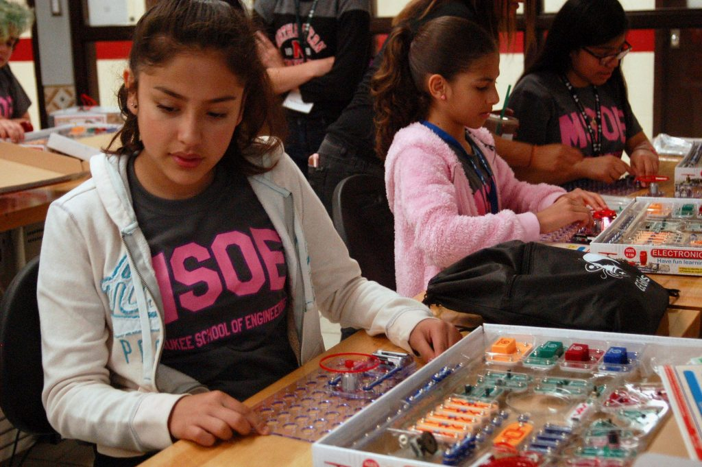 "Leslie Villanueva and Natalie Perez Rivera, students at Hayes Bilingual School, build ""Snap Circuits."" Photo by Hailey Richards."