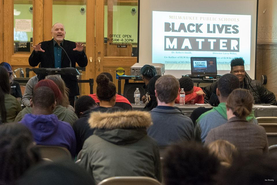MPS Board Vice President Larry Miller, who introduced the Black Lives Matter Resolution, addresses the crowd at a Feb. 17 event at City Hall. Photo by Joseph Brusky.