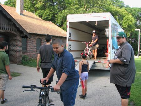 The Wisconsin Bike Fed distributes bikes to attendees of the Kinnickinnic River Trail Workshop in Pulaski Park. Photo by Lydia Slattery.