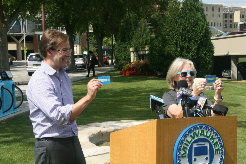 County Executive Chris Abele and Bublr executive director Sally Sheperdson show off the new Buslr card. Photo by Jeramey Jannene.