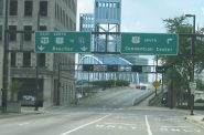 Highway signs downtown bode poorly for pedestrian safety. Photo: by SPUI.