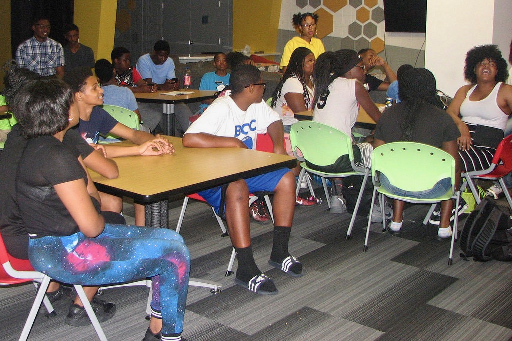Teenagers at the Mary Ryan Boys & Girls Club gather in the newly renovated center. Photo by Lydia Slattery.