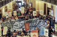 Supporters of undocumented immigrants gather recently at City Hall. Photo by Keith Schubert.