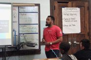 Reginald Kirby, Teach for America corps member, teaches an English class at Greenfield Elementary. Photo by Lydia Slattery.