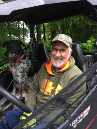 Yogi Antoniewicz along with his dog, Jaeger, enjoys riding on the designated roadway routes in Langlade County in his UTV. But he worries about the safety of young drivers of off-road machines mixing with larger, heavier vehicles. State law allows children as young as 12 to operate ATVs on roadways after receiving safety certification. Photo by Mary Matthias of the Wisconsin Center for Investigative Journalism.