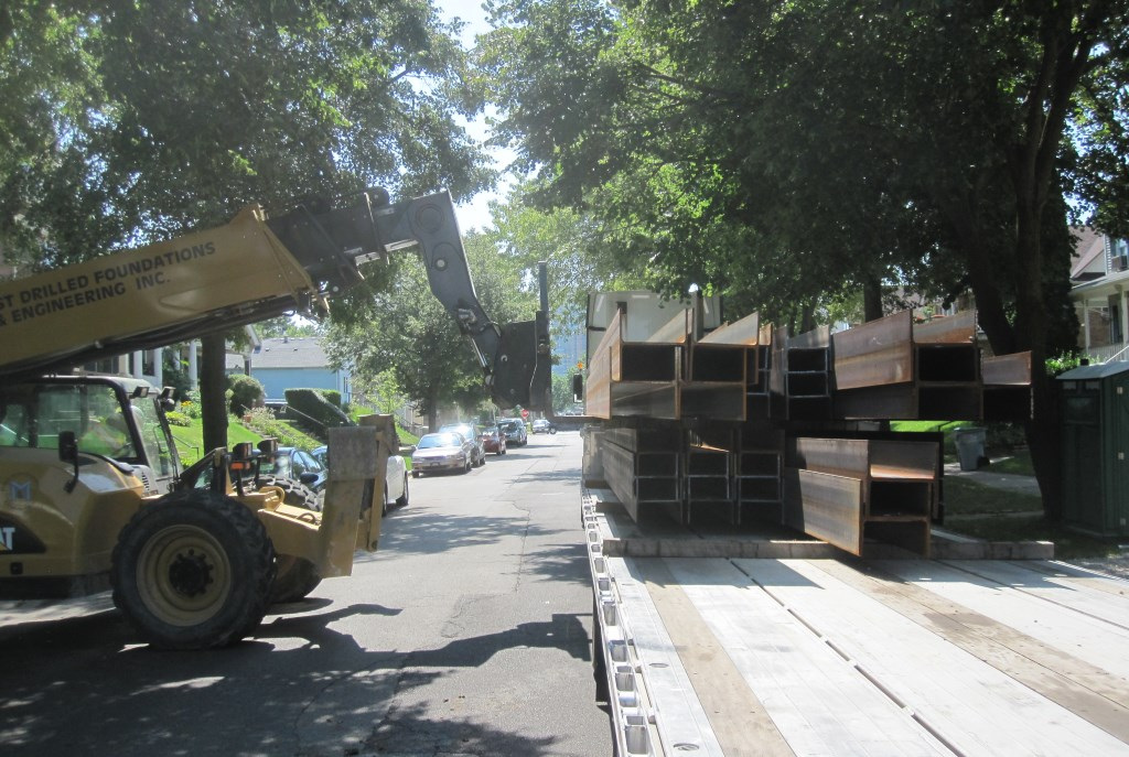 I-beams being delivered to 1641 N. Astor St. Photo by Michael Horne.