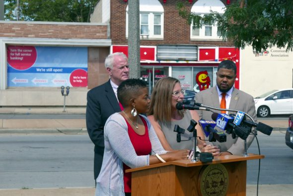 JoAnne Sabir and Juli Kaufmann with Mayor Barrett and Ald. Rainey in the background. Photo by Graham Kilmer.