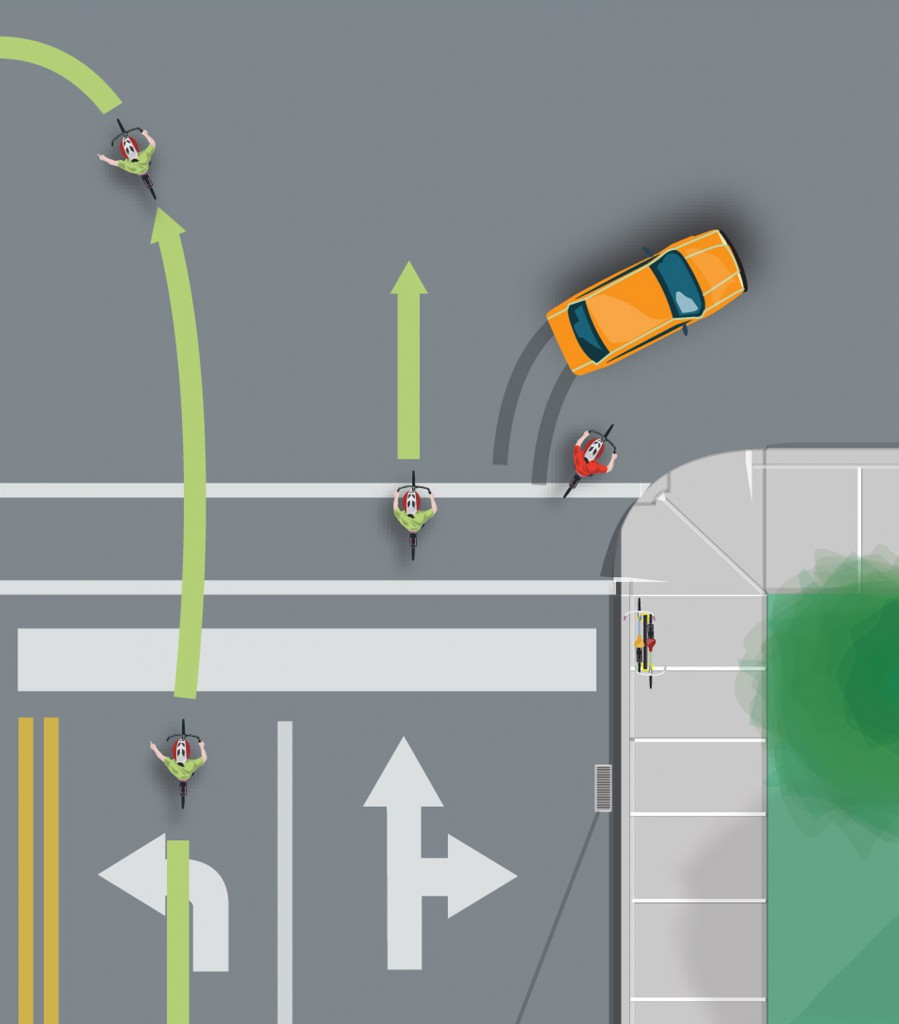 The green riders are in the correct position to ride though the intersection.