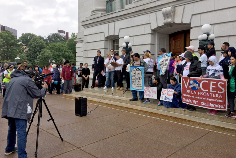 Immigrant dairy workers and their supporters, including Manuel and Jennifer Estrada, gather at the state Capitol in Madison, Wis. on June 28, 2017 to protest ramped up immigration enforcement policies under President Donald Trump and an anti-sanctuary proposal in the state Legislature. The rally was sponsored by the Milwaukee-based group, Voces de la Frontera. Photo by Alexandra Hall of WPR/Wisconsin Center for Investigative Journalism.