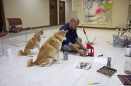 Artist Erick Ledesma makes pins in his studio accompanied by his pets, Phoenix and Leo. Photo by Emmy A. Yates.