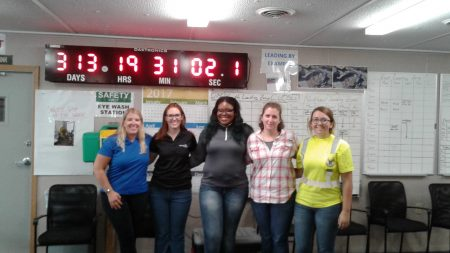 LaResha Love worked for Mortenson Construction as part of Milwaukee Public Schools' youth apprenticeship program. Love (center) poses with mentors Bridget Kraus, Vanessa Nsubuga, TJ Lewis and Carina Sowinski. Photo courtesy of Terri Salzer.