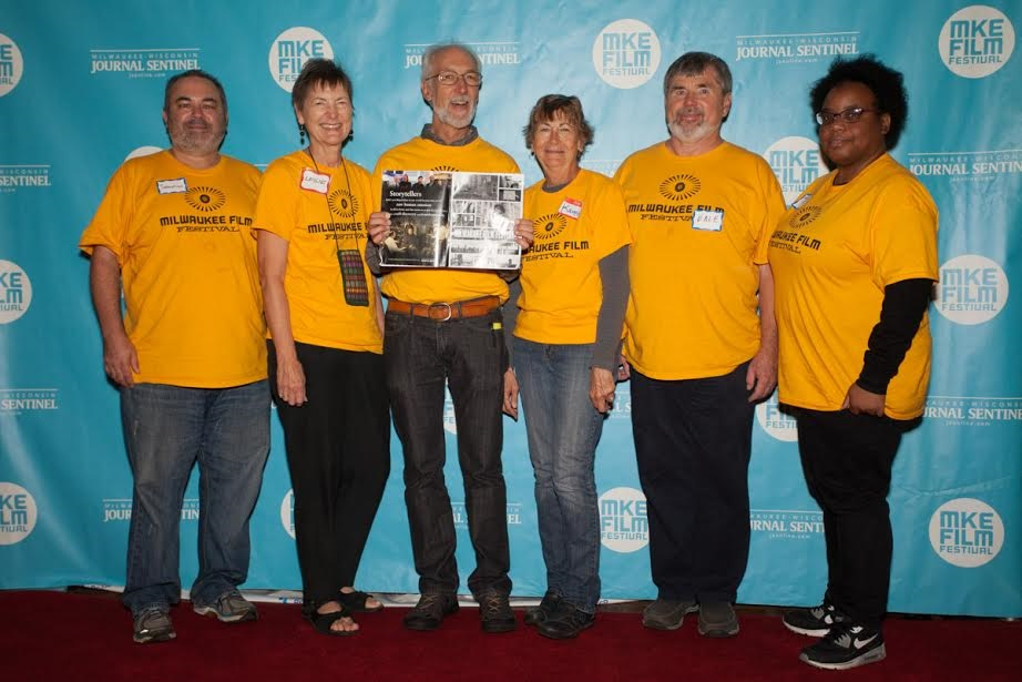 Karen is 4th from left (with her husband, Dale to her left) as part of a specialized team of volunteers who help seat thousands of students on weekday mornings during the festival at Education Screenings.