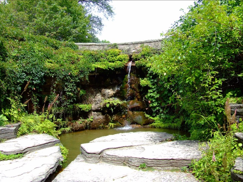 During the Great Depression, workers of the Civilian Conservation Corps created the naturalistic Rock Garden at Boerner Botanical Gardens. Today it is a popular site for wedding photography. Photo from Milwaukee County Parks.