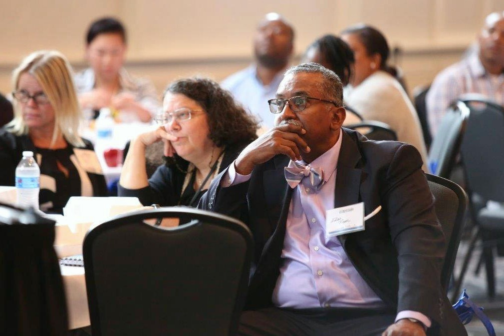 Fred Royal, the president of the Milwaukee NAACP chapter, listens to a speaker at the Social Development Commission's Summit on Poverty event (Photo by Dennis McMurray, courtesy of SDC).