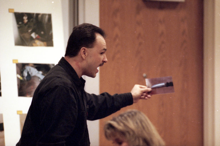 Ken Hudson, serving as his own attorney, shows a photo of the alleged murder weapon during his March 2001 trial at the Outagamie County Justice Center in Appleton, Wis. Hudson was found guilty of first-degree intentional homicide. He has appealed his conviction, alleging that he was framed. (Dan Powers / USA TODAY NETWORK-Wisconsin)