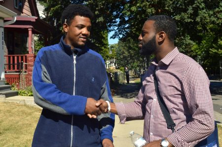 Tjuan Balfour (left), 23, shakes hands with Rep. David Bowen. Photo by Alexandria Bursiek.