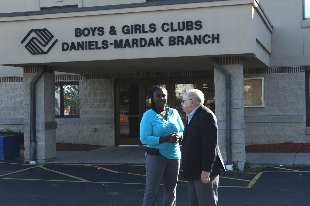 Parent Georgia Isaac speaks with donor Keith Mardak about the new Daniels-Mardak Club. Photo by Leah Harris.