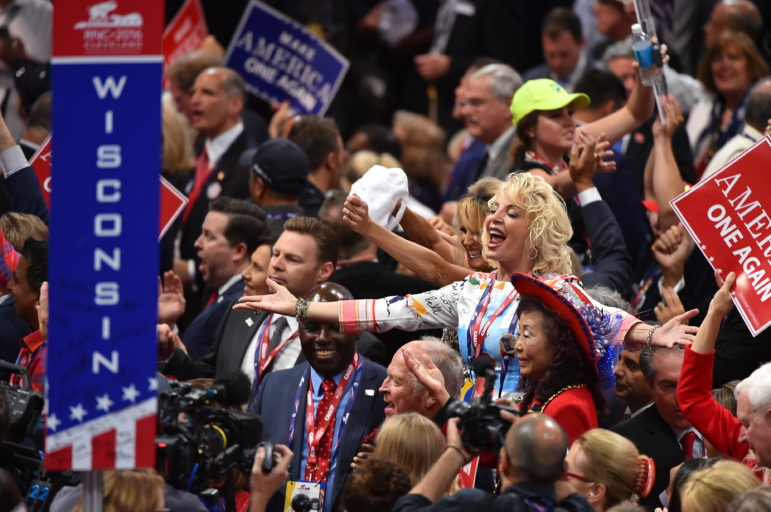 """Delegates celebrate on the last day of the 2016 Republican National Convention on July 21, 2016. The Center for Public Integrity has learned that nearly $1 million in previously unreported corporate donations were used to construct a """"cloakroom"""" at the Quicken Loans Arena in Cleveland, Ohio. Photo by Ricky Carioti / The Washington Post via Getty Images."""