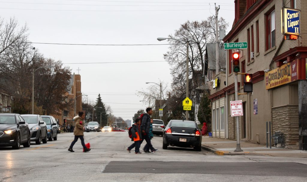 Children cross N. Holton Street, one of Milwaukee's racial dividing lines. (Photo by Jabril Faraj)