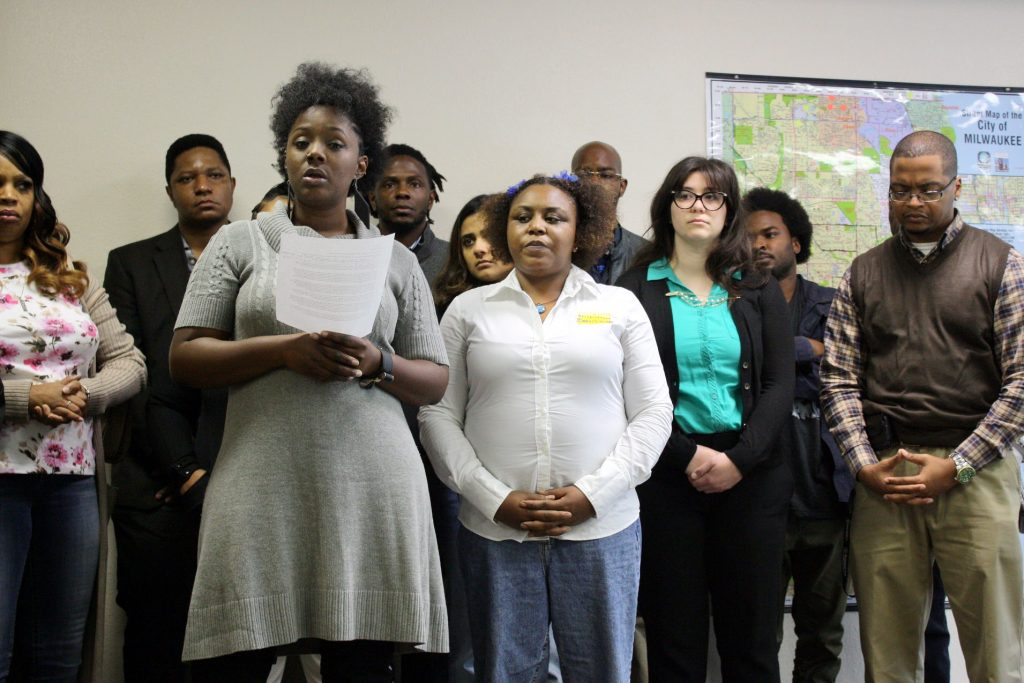 Markasa Tucker speaks during a news conference as representatives from the ACLU and Coalition for Justice look on. Photo by Jabril Faraj.