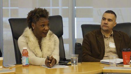 Danita Graham, program coordinator at PEARLS for Teen Girls (left), asks panelists a question as Jermaine Alexander (right), director of housing at the Sherman Park Neighborhood Association, listens. Photo by Elizabeth Baker.