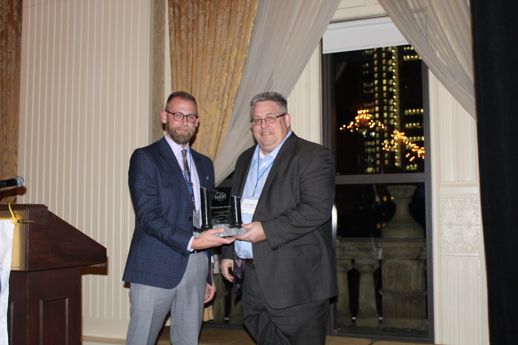 (l-r) Josh Brown, Milwaukee NARI President, presented the Building Milwaukee award to Andy Hepburn, Chief Innovation Officer, of GPS Education Partners. Photo courtesy of the Milwaukee NARI.