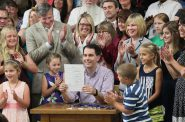 Gov. Scott Walker signs the 2015-17 Wisconsin state budget at Valveworks USA in Waukesha, Wis., on July 12, 2015. A provision in that document, approved by the Legislature with no debate, repealed the state False Claims Act. Because of that repeal, Wisconsin now collects millions of dollars less when companies are caught defrauding the state's Medicaid program. Photo by Michael Sears/Milwaukee Journal Sentinel.